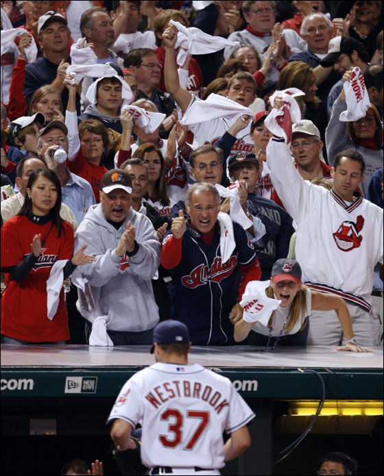 Fans cheer Cleveland Indians starting pitcher Jake Westbrook as he leaves the game during the seventh inning of Major League Baseball's ALCS playoff series against the Boston Red Sox in Cleveland October 15, 2007.