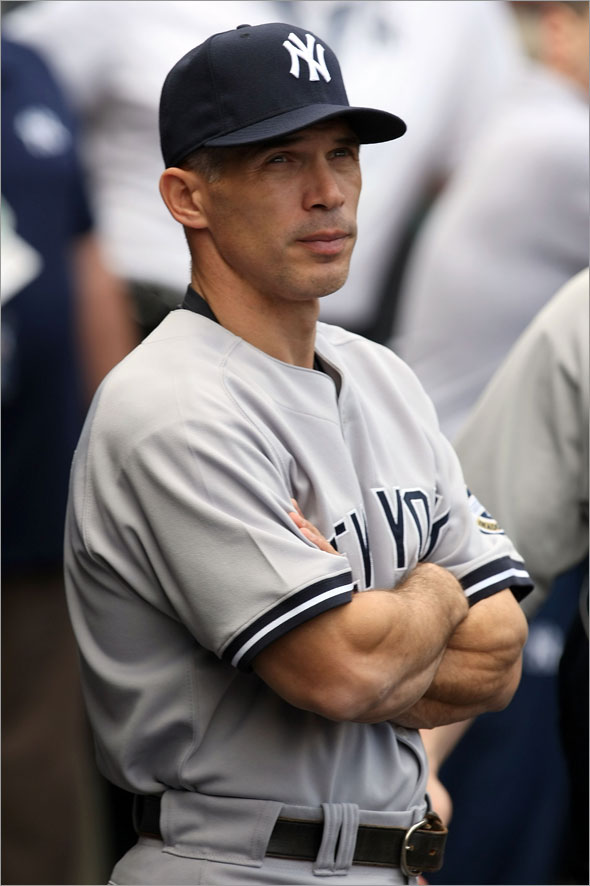 Manager Joe Girardi of the New York Yankees looks on during the Nation Anthem prior to the start of Game Three of the ALCS against the Los Angeles Angels of Anaheim during the 2009 MLB Playoffs at Angel Stadium on October 19, 2009 in Anaheim, California.