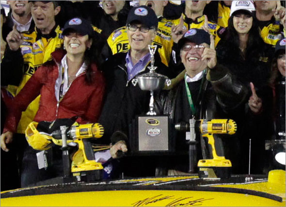 Linda Pizzuti, John Henry's fiance, John Henry, and team owner Jack Roush, Matt Kenseth and his crew celebrate after Kenseth won the the rain-shortened NASCAR Daytona 500 auto race at Daytona International Speedway in Daytona Beach, Fla., Sunday, Feb. 15, 2009.