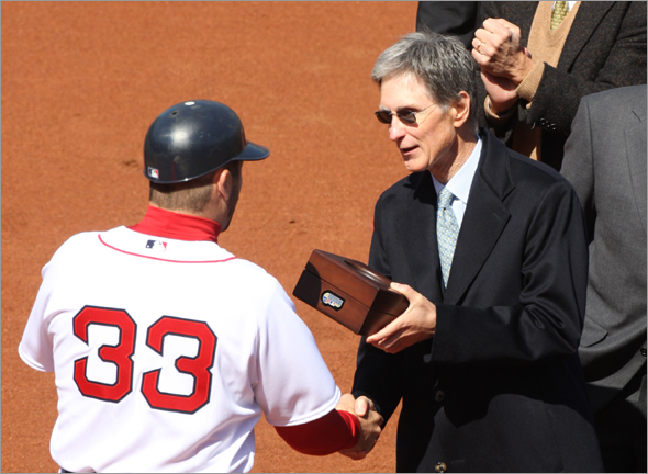 Red Sox catcher Jason Varitek, shown here receiving a World Series ring from principal owner John W. Henry during the ceremonies before the 2008 home opener, is meeting with the Sox owner