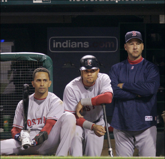 Red Sox shortstop Julio Lugo, second from left, Coco Crisp and manager Terry Francona, right, watch in the top of the ninth inning of their 4-2 Game 3 loss to the Cleveland Indians in the American League Championship baseball series Monday, Oct. 15, 2007, in Cleveland