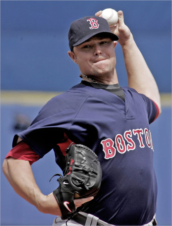 Red Sox starting pitcher Jon Lester sets to deliver his pitch in the first inning against the New York Mets during their spring training baseball game in Port St. Lucie, Fla., on Monday, March 10, 2008.