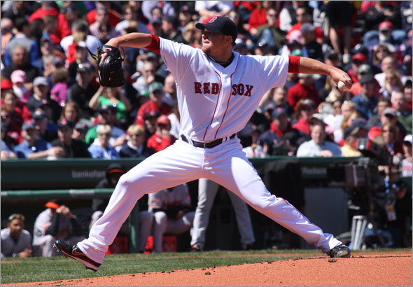 Red Sox pitcher Jon Lester throws during the first inning.