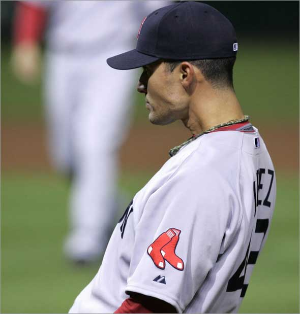 Javier Lopez watches the Cleveland Indians celebrate after the Indians won 9-8 in the ninth inning on an error by Lopez in a baseball game, Tuesday, April 28, 2009, in Cleveland.
