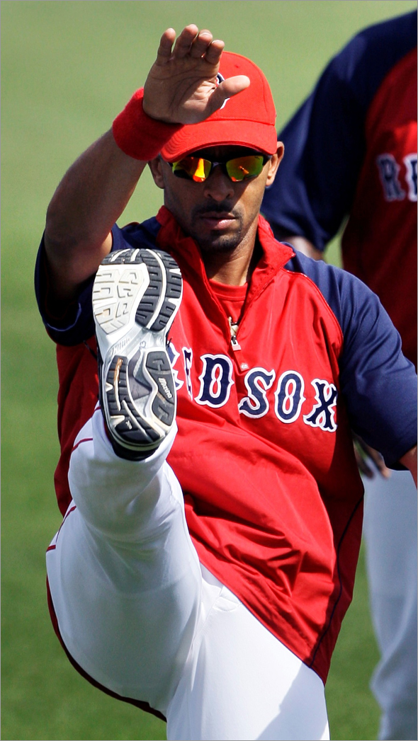 Boston Red Sox shortstop Julio Lugo kicks his right leg while working out prior to Friday's game against the New York Yankees in Fort Myers, Fla., Friday March 13, 2009. According to manager Terry Francona, Lugo later left during the first inning of the game with soreness in his knee