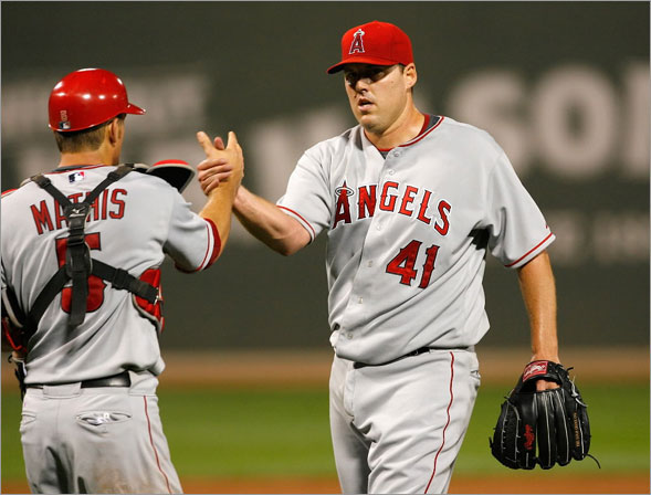 John Lackey of the Los Angeles Angels of Anaheim is congratulated by catcher Jeff Mathis after throwing a two-hiiter against the Boston Red Sox at Fenway Park on July 29, 2008 in Boston, Massachusetts.