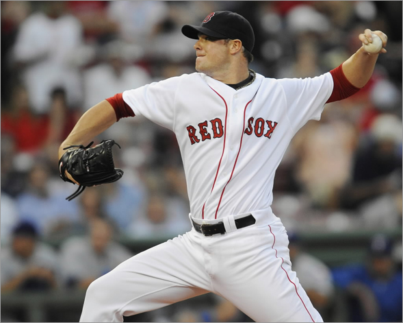 Red Sox starting pitcher Jon Lester works during the first inning as the Boston Red Sox host the Texas Rangers in an MLB game played at Fenway Park in Boston, MA Wednesday, August 13, 2008.