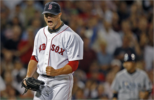 Red Sox pitcher Jon Lester reacts after striking out the Rays Rocco Baldelli to end the top of the sixth inning, and strand two Tampa Bay runners on base.
