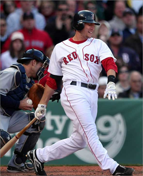 Jason Lowrie grimaces as he strikes out with two runners on in the 8th inning with Sox down 4-2. Boston Globe staff photo by John Tlumacki