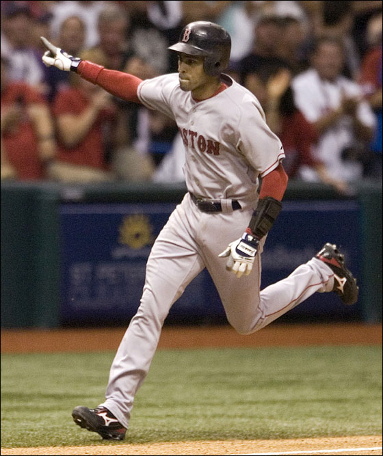 Boston Red Sox's Julio Lugo rounds third base after hitting a two-run homer off Tampa Bay Devil Rays closer Al Reyes during the ninth inning of a baseball game Saturday, Sept. 22, 2007, in St. Petersburg, Fla. Boston won 8-6.