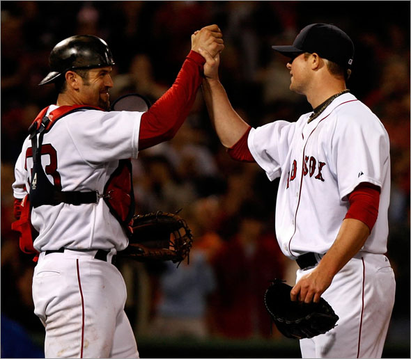 Boston Red Sox catcher Jason Varitek (33) congratulates Boston Red Sox starting pitcher Jon Lester (31) after his 2 hit 1 run complete game against the Texas Rangers.