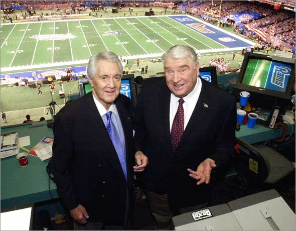 Fox broadcasters Pat Summerall, left, and John Madden stand in the FOX broadcast booth at the Louisiana Superdome before Super Bowl XXXVI Sunday, Feb. 3, 2002, in New Orleans.