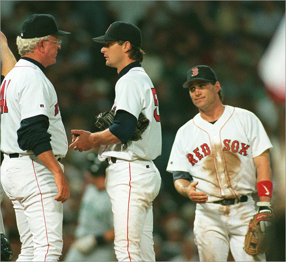 5/21/96 -- Red Sox vs. Mariners Sox pitching coach Sammy Ellis takes trip to mound to have a word w/ Sox No. 50 Jamie Moyer + Sox No. 11 Tim Naehring looks on