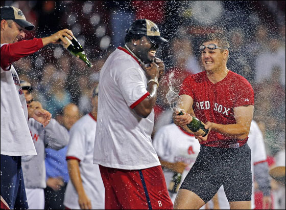 Tim Wakefield, David Ortiz and Jonathan Papelbon celebrate on the field. The Red Sox clinched the 2007 American League East Championship with a victory over the Minnesota Twins, combined with the Yankees loss to the Devil Rays in Tampa.