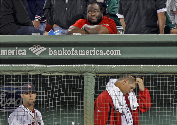 Pedroia and Papelbon leave the dugout after the devastating loss