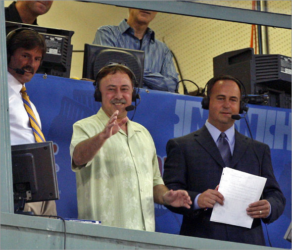 Red Sox announcer Jerry Remy waves to the crowd from the broadcast booth at Fenway Park during a baseball game against the Detroit Tigers in Boston Wednesday, Aug. 12, 2009. Remy said he hopes to be on the air soon after taking an indefinite leave of absence to recover from cancer surgery