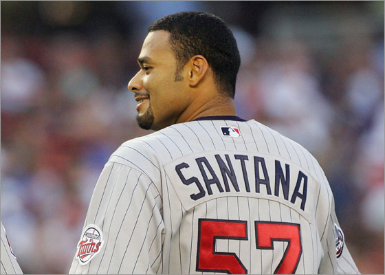 Johan Santana #57 of the Minnesota Twins looks on against the New York Mets during their interleague game at Shea Stadium June 19, 2007 in the Flushing neighborhood of the Queens borough of New York City.