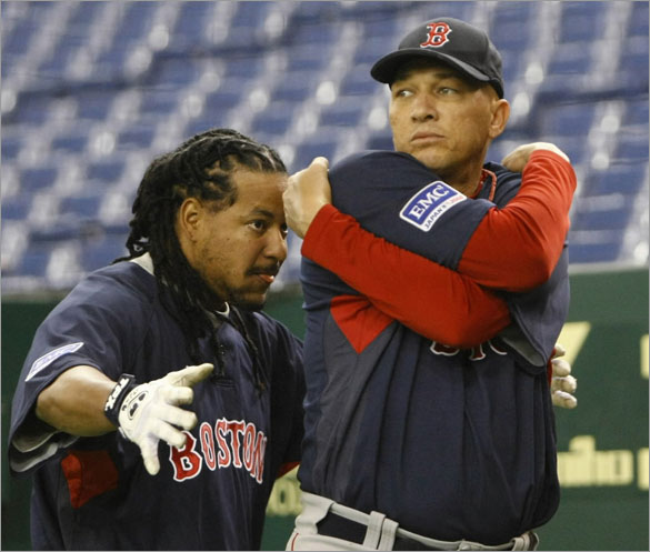 Red Sox slugger Manny Ramirez (L) plays with Julian Tavarez before a workout session at Tokyo Dome, March 21, 2008, ahead of their season-opening baseball games against the Oakland Athletics. The Red Sox will play the Athletics on March 25 and 26 in Japan.