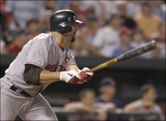 Boston Red Sox' Jason Varitek follows through on a RBI-single against the Baltimore Orioles during the ninth inning of a baseball game Thursday, Sept. 6, 2007, in Baltimore. The go-ahead run gave the Red Sox a 7-6 win.(