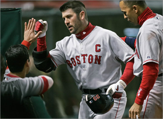 Jason Varitek is congratulated at the dugout after his solo home run off Cleveland Indians relief pitcher Jensen Lewis in the ninth inning of a baseball game Tuesday, April 15, 2008, in Cleveland. At right is Julio Lugo. Varitek's homer broke a 3-3 tie and Boston went on to win 5-3.