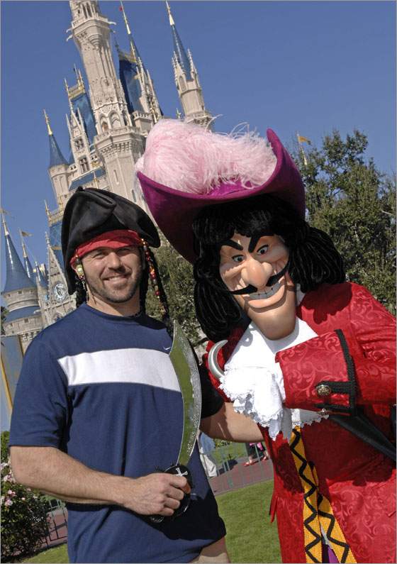 Boston Red Sox team captain Jason Varitek faces off with another noted captain, Captain Hook, Dec. 27, 2007 at the Magic Kingdom theme park.   Varitek, catcher for the Red Sox, recently helped lead his team to the 2007 World Series Championship in November.  Varitek is vacationing with family and friends at the Walt Disney World Resort in Lake Buena Vista, Fla. Christmas week.