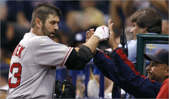 Boston Red Sox Jason Varitek celebrates solo home run in the sixth inning against the Tampa Bay Rays in Game 6 of Major League Baseball's ALCS playoff series in St. Petersburg
