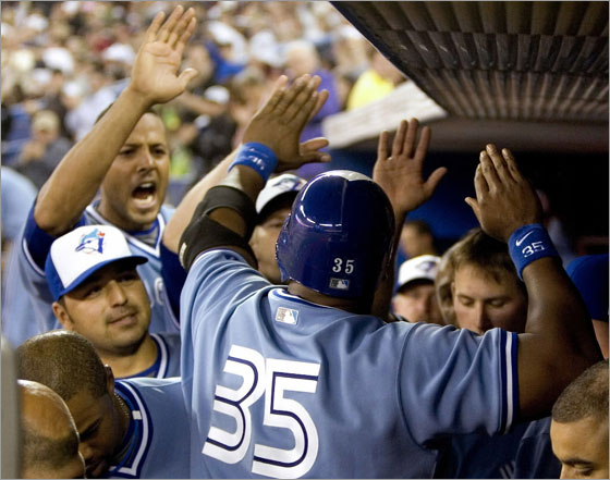 Frank Thomas is congratulated in the dugout by teammates after he doubled in two runs in the seventh inning of their MLB baseball game against the Boston Red Sox in Toronto April 4, 2008.
