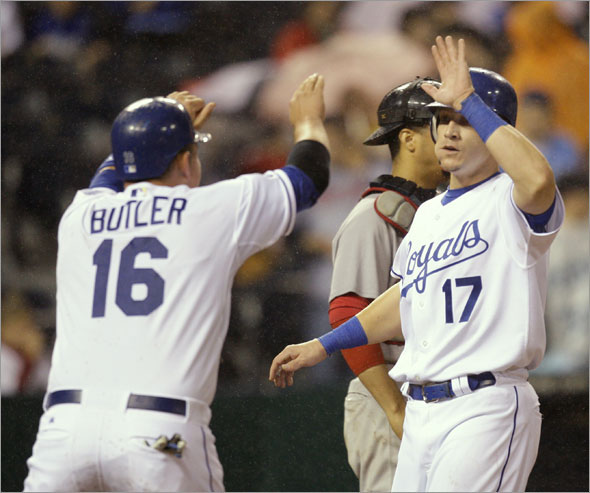 Mike Jacobs (17) and Billy Butler (16) celebrate after scoring on a double by Alberto Callaspo during the sixth inning of a baseball game against the Boston Red Sox on Monday