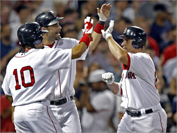 Red Sox catcher Kevin Cash is welcomed back to the dugout following his bottom of the eighth inning three run home run by teammates Coco Crisp and Mike Lowell.