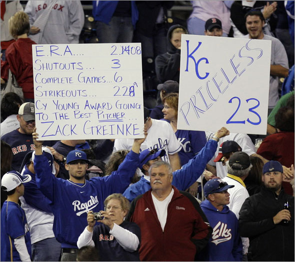 Fans hold up signs praising Kansas City Royals starting pitcher Zack Greinke after the Royals beat the Boston Red Sox 5-1 in a baseball game Tuesday, Sept. 22, 2009