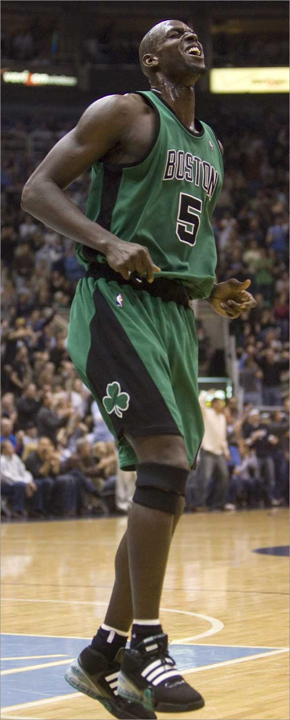 This is a Feb. 19, 2009, file photo showing Boston Celtics forward Kevin Garnett hopping in pain during the second quarter against the Utah Jazz in an NBA basketball game in Salt Lake City.