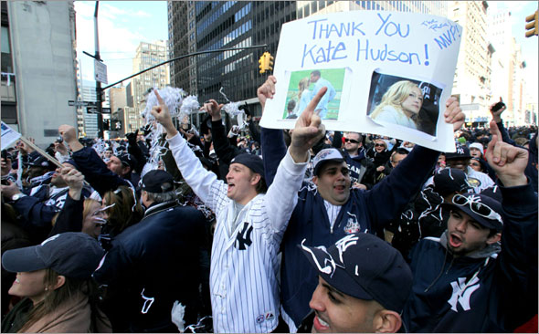 Chris Sessa holds a sign with a picture New York Yankees' Alex Rodriquez and Kate Hudson during a ticker-tape parade along Broadway celebrating their 27th World Series championship on Friday, Nov. 6, 2009, in New York.
