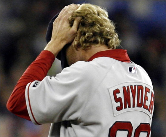 Boston Red Sox reliever Kyle Snyder rubs his head while waiting to be relieved during the sixth inning of their baseball game against the Toronto Blue Jays in Toronto on Saturday, April 5, 2008. The Jays scored six runs in the inning, going on to defeated the Sox 10-2.