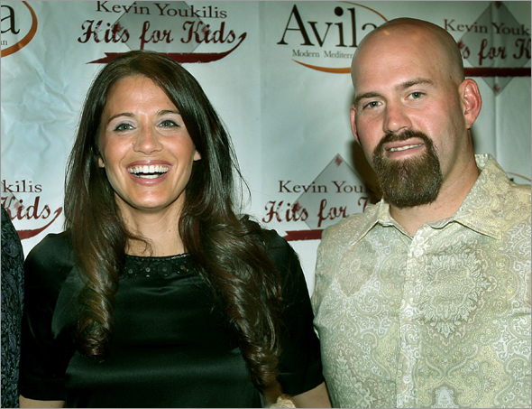 Oct. 20: Red Sox Kevin Youkilis Hits for Kids Celebrates it's First Year, he raised over 800,000 dollars, the event was held at Avila Restaurant in Park Sq. (left to right) are Red Sox catcher Jason Varitek with Enza Sambararo and Red Sox First baseman Kevin Youkilis.