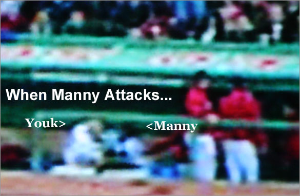 Manny charges Youk in the dugout after the fourth inning