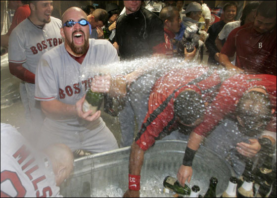 Kevin Youkilis wears goggles as he sprays champagne while celebrating the team's victory over the Los Angeles Angels of Anaheim in Game 3 of their MLB American League Division Series playoff baseball game
