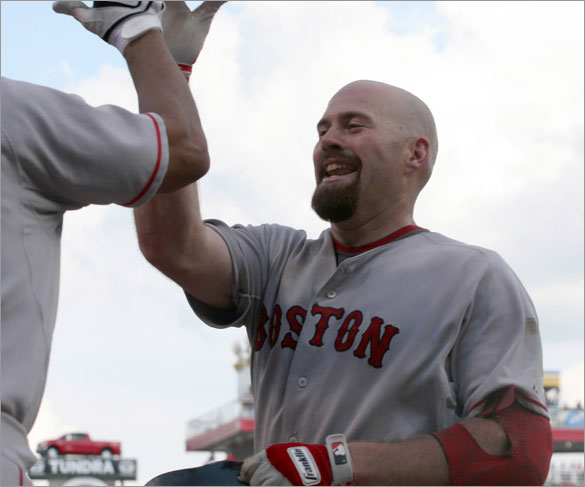 Red Sox Kevin Youkilis, right, is congratulated by Alex Cora, left, after Youkilis hit a solo home run off Cincinnati Reds pitcher Mike Lincoln in the 10th inning of a baseball game, Saturday, June 14, 2008 in Cincinnati. The Red Sox won, 6-4.