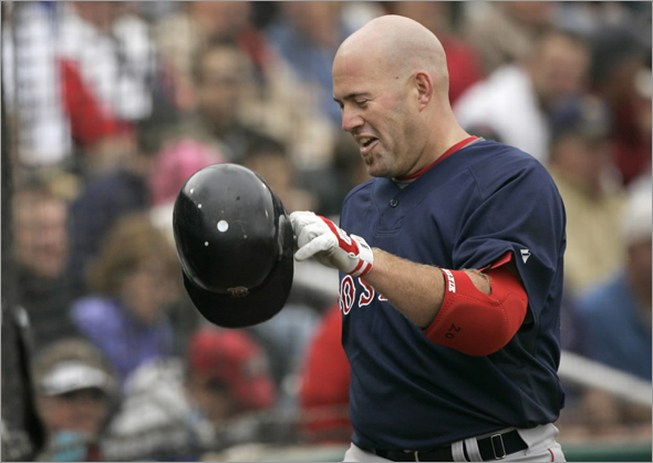 Boston Red Sox's Kevin Youkilis smiles as he heads toward the dugout after hitting a home run off Minnesota Twins pitcher Craig Breslow in the seventh inning of a spring training baseball game, in Fort Myers, Fla., Sunday, March 1, 2009. The Red Sox beat the Twins 2-1.