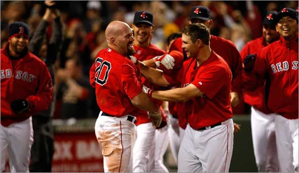Red Sox first baseman Kevin Youkilis is on the end of the receiving line after his walk off HR in the 11th.