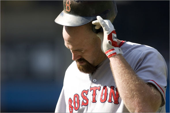 Red Sox's Kevin Youkilis reacts after flying out to right during the third inning of a baseball game against the Toronto Blue Jays in Toronto on Saturday, Sept. 20, 2008.