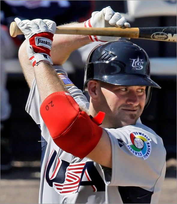 Team USA's Kevin Youkilis bats in the sixth inning against the New York Yankees in an exhibition spring baseball game in Tampa, Fla., Tuesday, March 3, 2009.