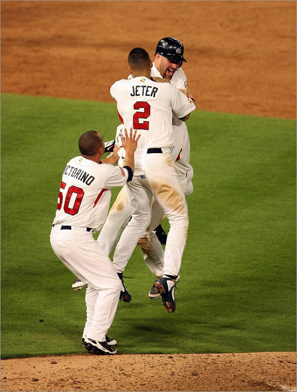 Jeter jumps on Youkilis after Team USA defeats Puerto Rico