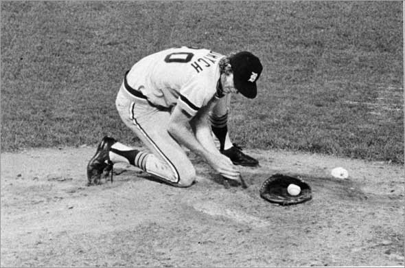 6/24/1976 Fenway Park, during a Red Sox vs Detroit Tigers. Mark Fidrych of Detroit Tigers digs a small hole so he will have good footing while pitching.