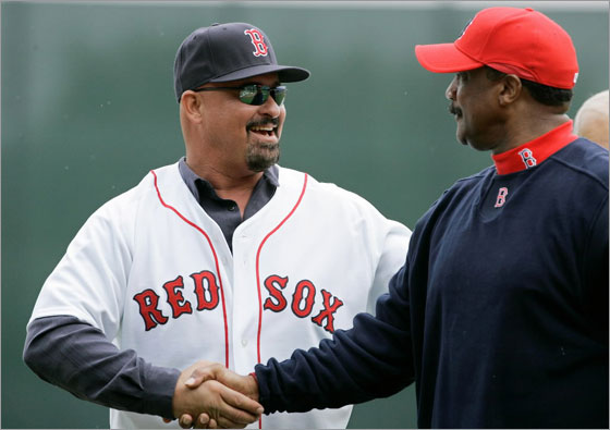 Former Boston Red Sox left fielder Mike Greenwell, left, shakes hands with former teammate Jim Rice after throwing out the ceremonial first pitch prior to the Red Sox-New York Mets spring training baseball game in Fort Myers, Fla., Tuesday March 11, 2008.