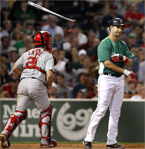 A frustrated Mike Lowell tosses his bat after striking out in the 7th to end the inning.