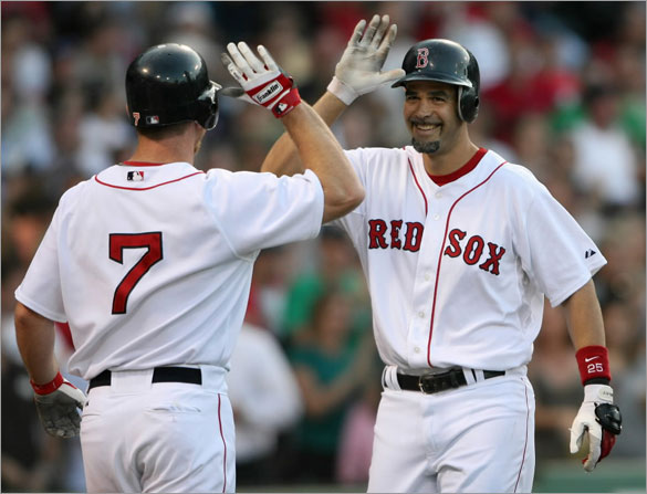 Mike Lowell of the Boston Red Sox celebrates his grand slam with teammate J.D. Drew #7 at Fenway Park June 12, 2008 in Boston, Massachusetts.