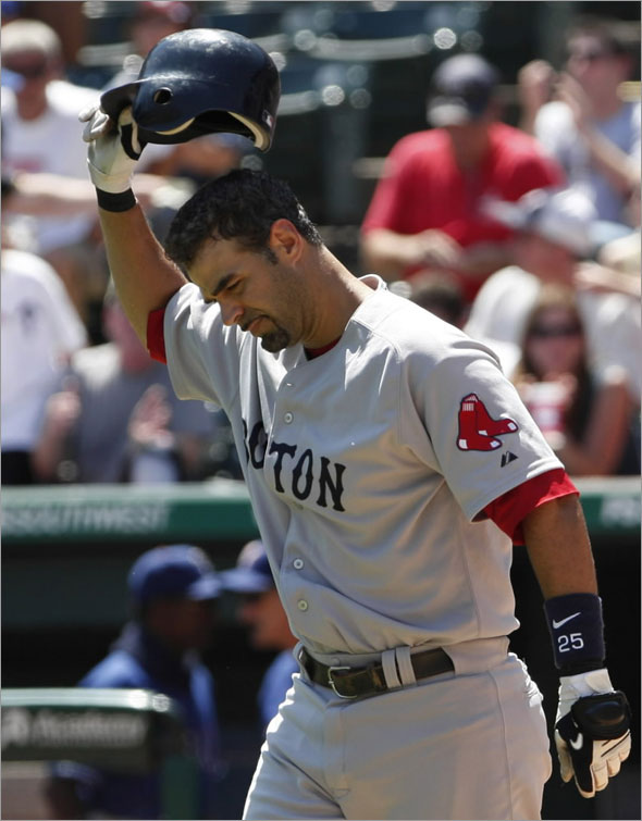 Boston Red Sox Mike Lowell throws his batting helmet after striking out against the Texas Rangers during the fifth inning of their game in Arlington, Texas August 16, 2009.