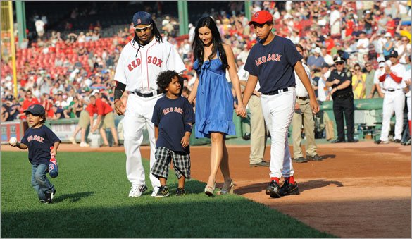 Red Sox left fielder Manny Ramirez walks with his family including sons Lucas, Manny Jr. and Manuel and his wife Juliana prior to his being honored for hitting 500 career home runs.