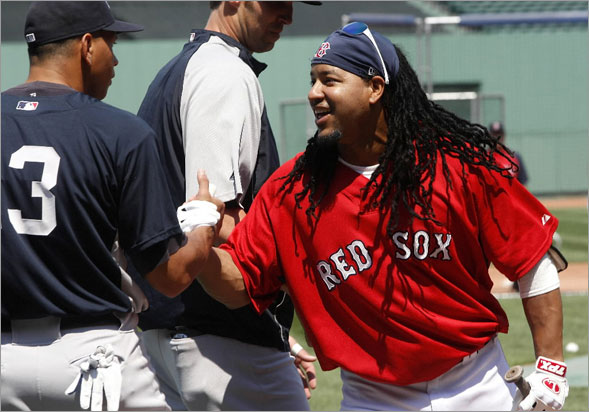 Manny Ramirez is greeted by New York Yankees third baseman Alex Rodriguez.