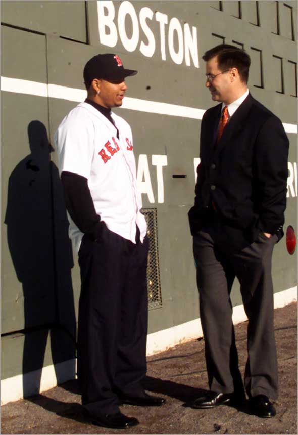 12.13.2000: Manny Ramirez and GM Dan Duquette visit out in LF by the Green Monster after today's press conference introducing Ramirez to the Boston Media.